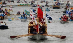 The Gloriana leads the manpowered craft towards Westminster Bridge